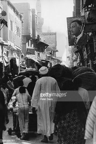 View of pedestrians on a crowded street Cairo Egypt 1970 The banner at right depicts Egyptian President Gamal Abdel Nasser