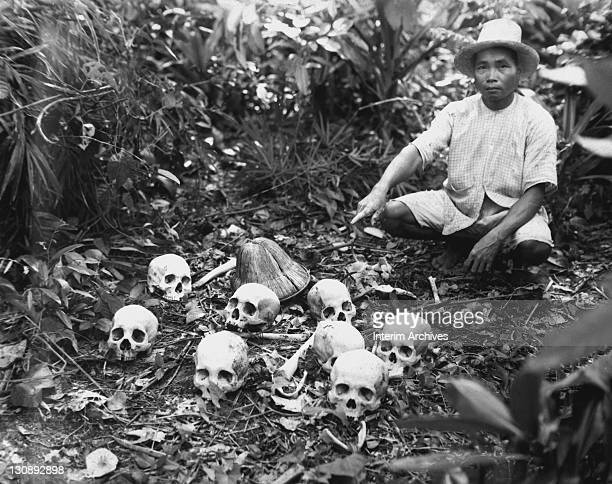 View of Pedro Cerono who discovered the group of eight skulls pointing to them as evidence of the Tapel Massacre by the Japanese Army in Cagayan...