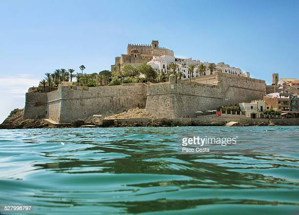 view of peñiscola's castle from inside the sea - castellon province stock pictures, royalty-free photos & images