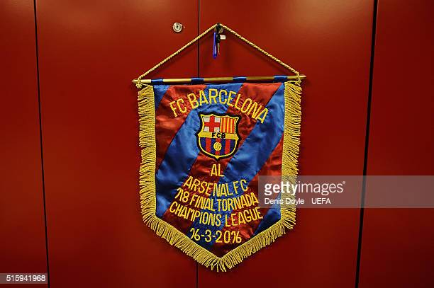 View of pennant to commemorate the match between FC Barcelona and Arsenal FC in the Barcelo0na changing room ahead of the UEFA Champions League Round...