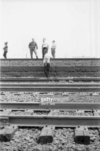 View of people, among them several children, as they line train tracks to wait for Robert F Kennedy's funeral train, Elizabeth, New Jersey, June 8,...