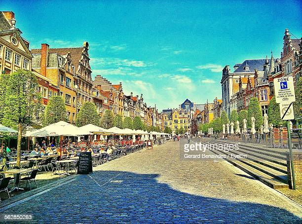 view of people at outdoors cafe on street - leuven stock pictures, royalty-free photos & images