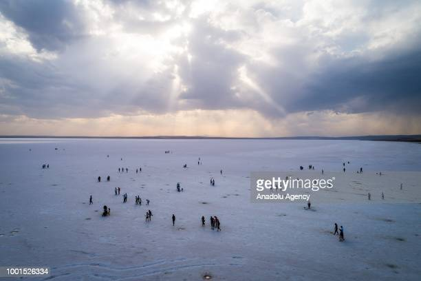 A view of people at the Lake Tuz about 130 km from Ankara Turkey on July 19 2018 Lake Tuz is the second largest lake in Turkey In summer times the...