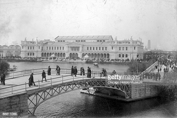 View of people crossing a bridge leading to the Women's Building at the Chicago World's Columbian Exposition of 1893 Chicago IL