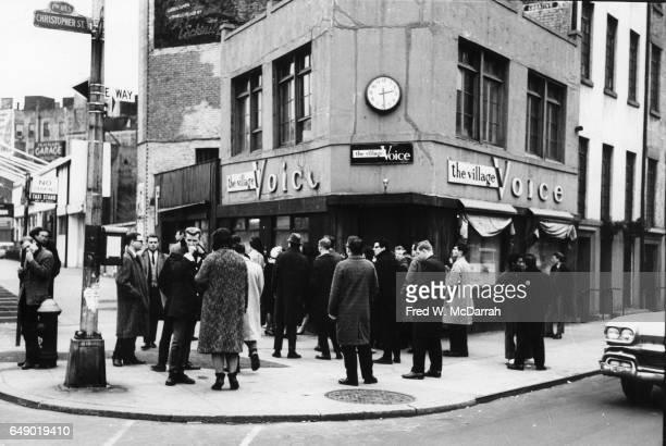 View of people gathered outside the offices of the Village Voice weekly newspaper as they wait for the latest edition New York New York January 15...