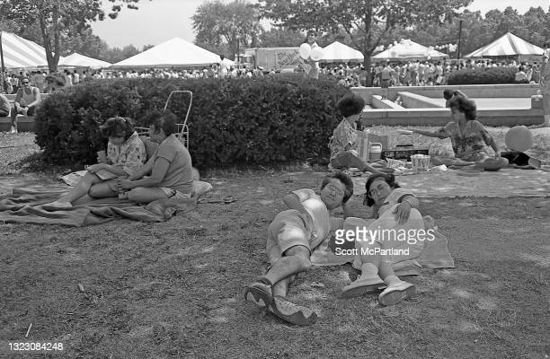 View of people lying on the grass in Flushing Meadows Park, in the Corona neighborhood, Queens, New York, New York, June 29, 1986.