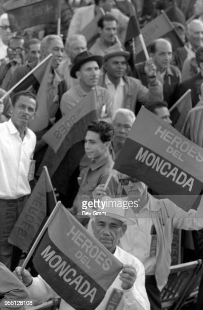 View of people many with flags that read 'Heroes del Moncada' in la Plaza de la Revolucion during the 10th anniversary celebration of the Cuban...