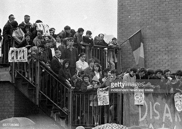 View of people many with signs as they stand on a tower block staircase in the Bogside neighborhood during a visit by the British Home Secretary in...
