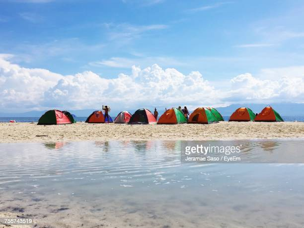 view of people on beach against sky - cebu stock photos and pictures