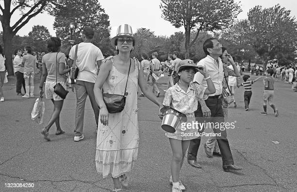 View of people on the foot paths in Flushing Meadows Park, in the Corona neighborhood, Queens, New York, New York, June 29, 1986.