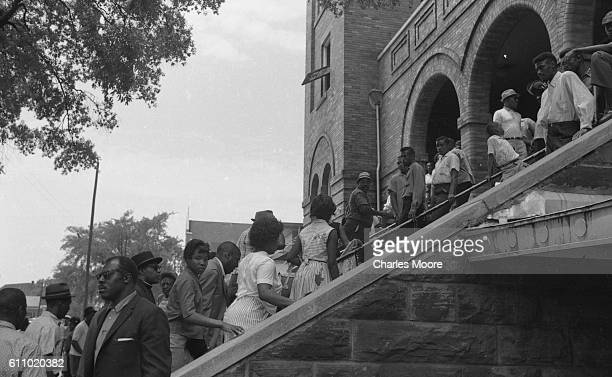View of people on the staircase of the 16th Street Baptist Church near Kelly Ingram Park Birmingham Alabama 1963