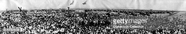 View of people perhaps at the Silver Spike Ceremony in which the Secretary of the Interior Ray Lyman Wilbur struck the first spike in a ceremony that...