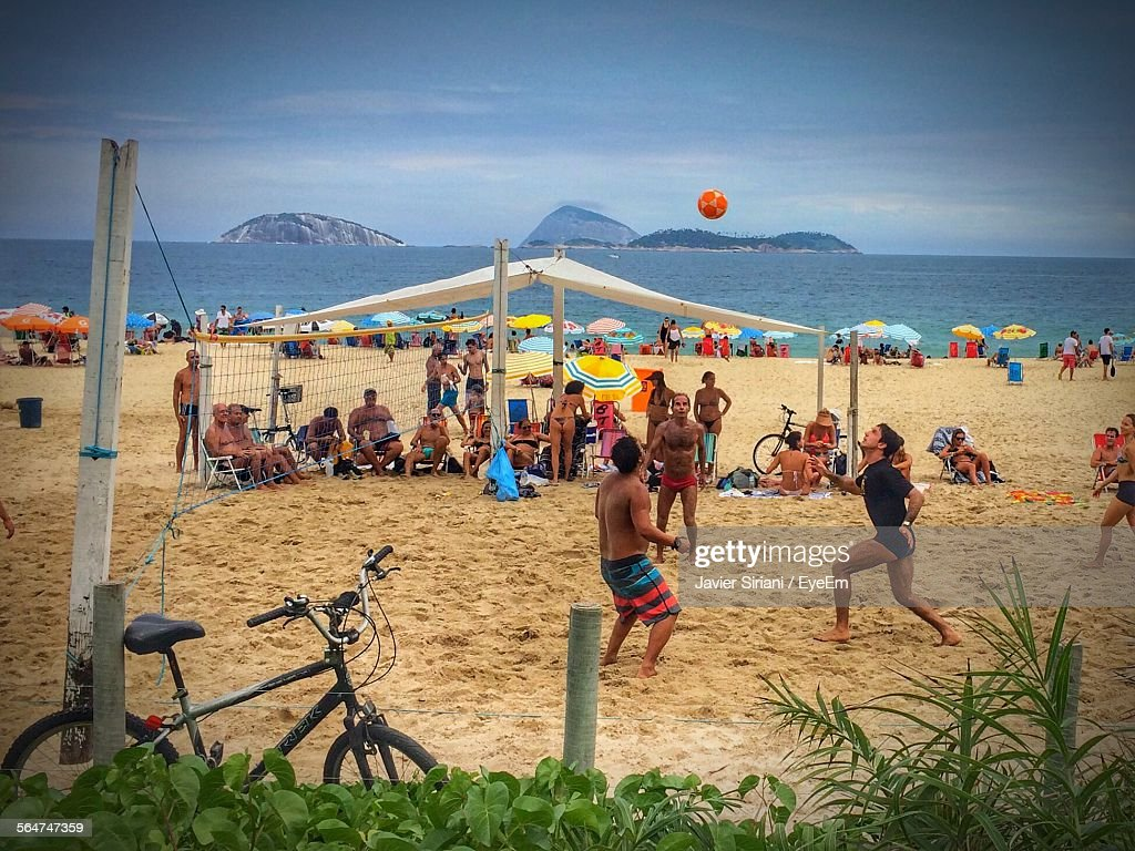 View Of People Playing Volleyball On Beach : Stock Photo