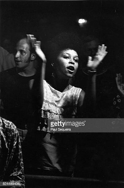 View of people reacting to a speech by Black Panther Party leader Fred Hampton at the People's Church on Ashland Avenue Chicago Illinois 1969