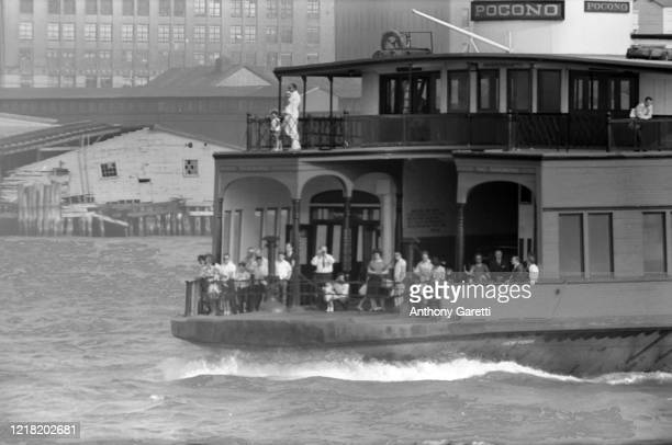 View of people riding the Staten Island Ferry in New York Harbor in New York City, New York circa 1965.