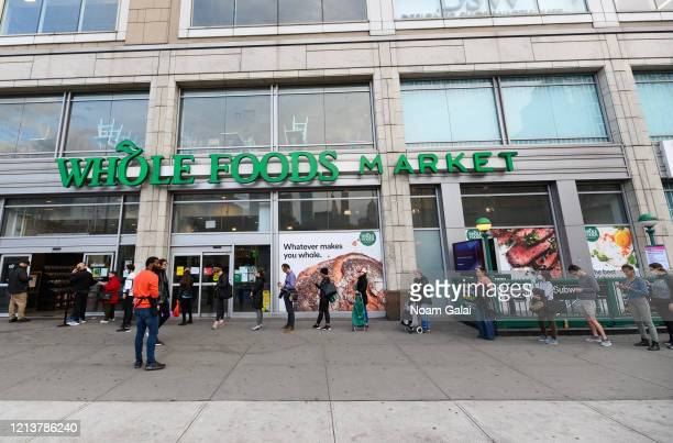 View of people standing in line outside Whole Foods Market in Union Square as the coronavirus continues to spread across the United States on March...