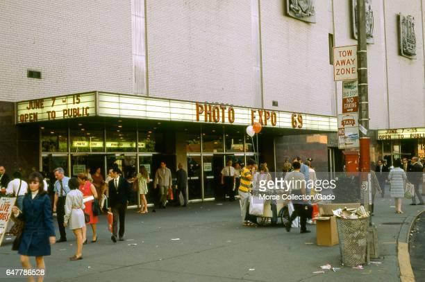 View of people walking outside of the New York Coliseum convention center at Columbus Circle and 58th Street on the west side of Manhattan New York...