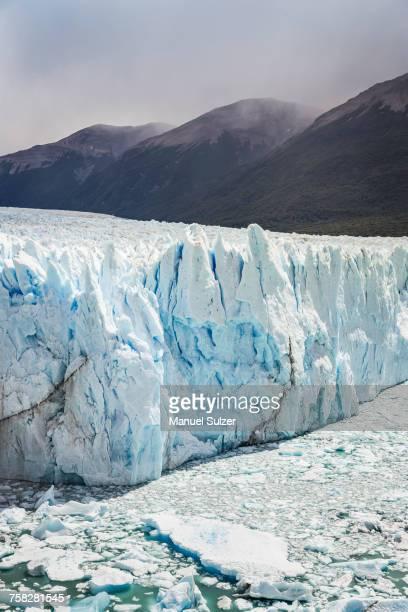 View of Perito Moreno Glacier and low cloud over mountains, Los Glaciares National Park, Patagonia, Chile