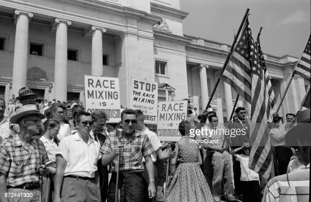 View of perticipants in an antiintegration rally on the steps of the Arkansas State Capitol Little Rock Arkansas August 20 1959 Several carry...