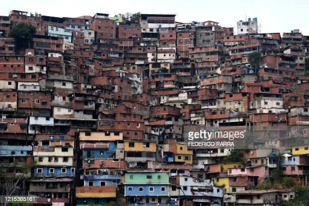 View of Petare neighbourhood in eastern Caracas, taken on May 24, 2020 during the COVID-19 coronavirus pandemic. - Overcrowded neighbourhoods and a...