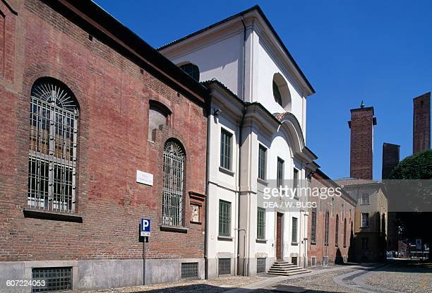 View of piazza Leonardo da Vinci and the medieval towers Pavia Lombardy Italy