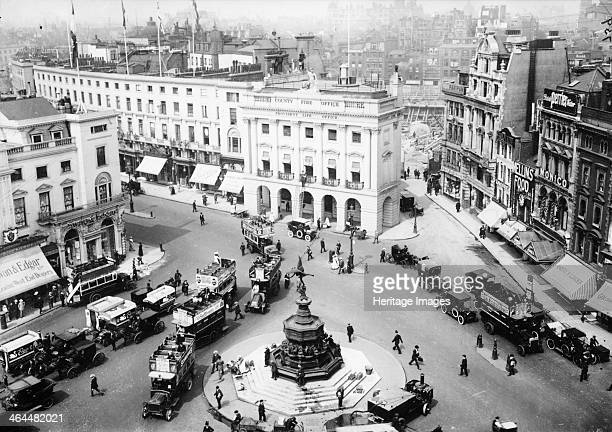 A view of Piccadilly Circus c1912c1914 A rooftop view looking down on the Statue of Eros with lines of buses and cars