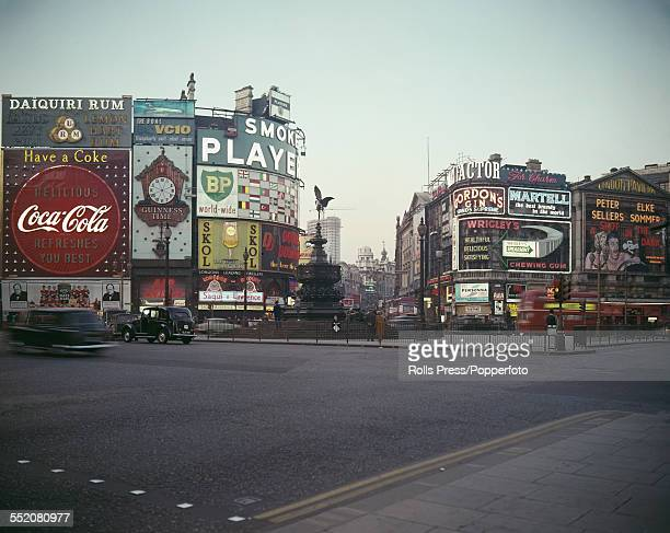View of Piccadilly Circus from the corner of Piccadilly and Lower Regent Street showing the Shaftesbury Memorial Fountain and statue of Eros along...