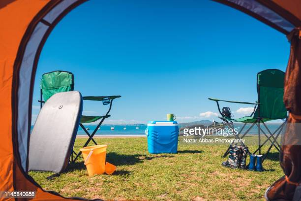 view of picnic on beach from a tent. - nazar abbas photography stock pictures, royalty-free photos & images