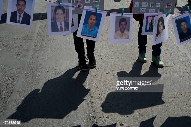 View of pictures of missing people during the Mother's Day commemoration in Mexico City on May 10 2015 Hundreds of mothers and relatives of missing...