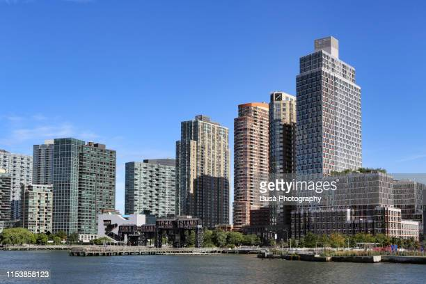 view of pier and highrise residential buildings at gantry plaza state park in long island city, queens, new york city - state park stock pictures, royalty-free photos & images