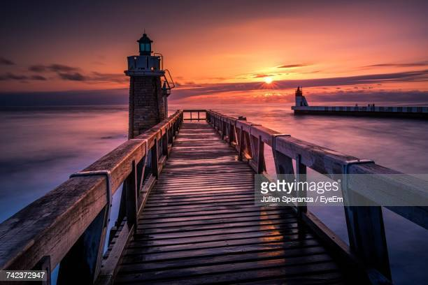 view of pier at sunset - vaud canton stock photos and pictures