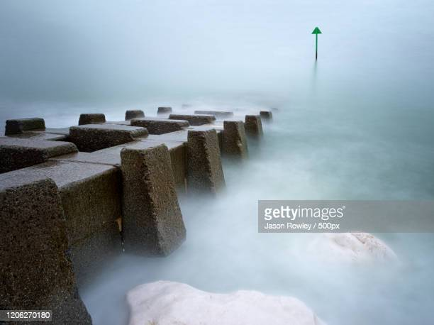 view of pier in foggy day, llandudno, wales, uk - llandudno wales stock pictures, royalty-free photos & images
