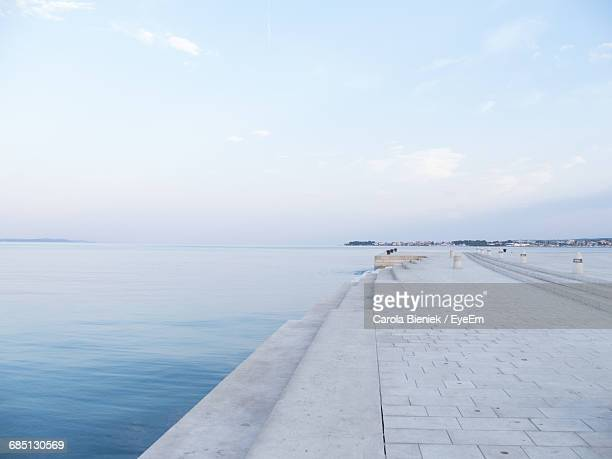 View Of Pier On Calm Sea Against Sky