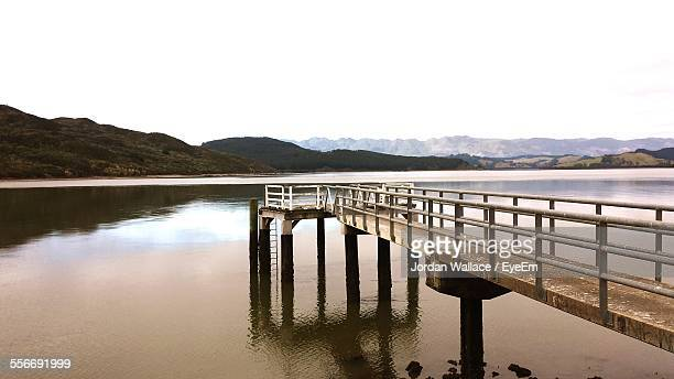 view of pier on lake - whangarei heads stock-fotos und bilder