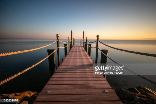 view of pier over sea against sky during sunset, horn, thurgau, switzerland - jetty stock pictures, royalty-free photos & images