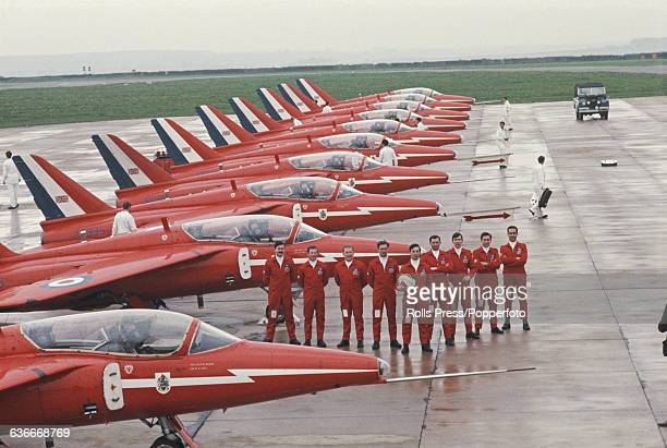 View of pilots and Hawker Siddeley Gnat jet aircraft of the Red Arrows the Royal Air Force Aerobatic Team pictured together on the apron at RAF...