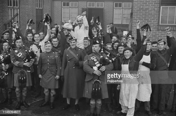 View of pipers and soldiers from the Canadian Scottish Regiment piping in the haggis during New Year celebrations at Aldershot Barracks in Hampshire...