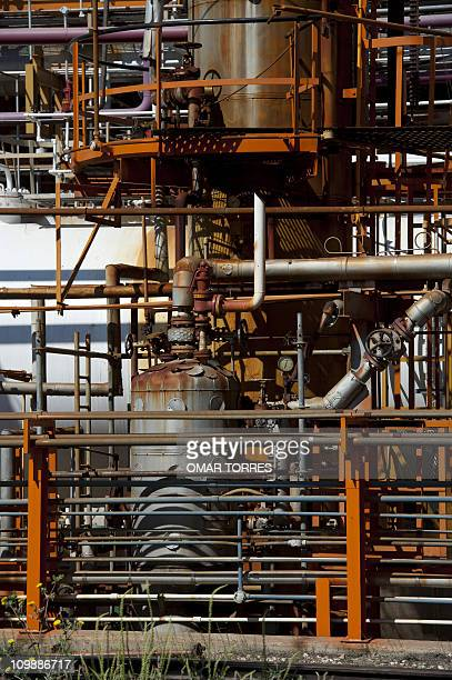 View of pipes tanks and valves in one of the plants at Mexican stateowned petroleum company PEMEX refinery in Tula Hidalgo state Mexico on March 8...