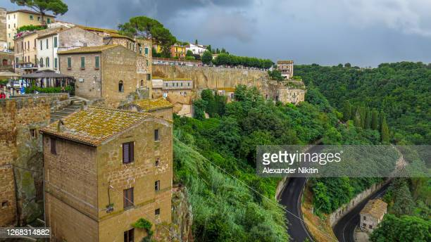 view of pitigliano city before heavy rain - san rafael california stock pictures, royalty-free photos & images
