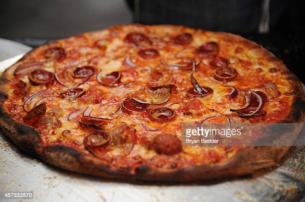 A view of pizza at a chef station at Ronzoni's La Sagra Slices hosted by Bongiovi Brand pasta sauces Adam Richman presented by Time Out New York...
