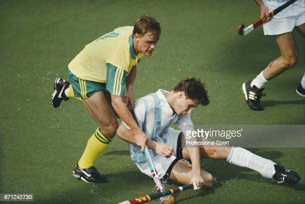 View of play between Australia and Argentina with Australia player tackling Argentina player for the ball in the group A preliminary round of the...