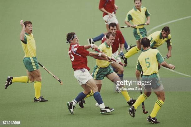 View of play between Great Britain and Australia with Sean Kerly of Great Britain clashing sticks with an Australian player in the group A...