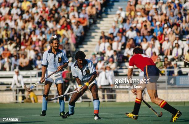 View of play between India and Spain in the final first place match of the Men's field hockey tournament at the 1980 Summer Olympics in Moscow,...
