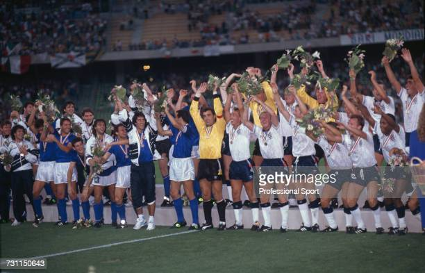 View of players from Italy and England teams pictured with their medals partaking in a mexican wave celebration at the end of the third place match...