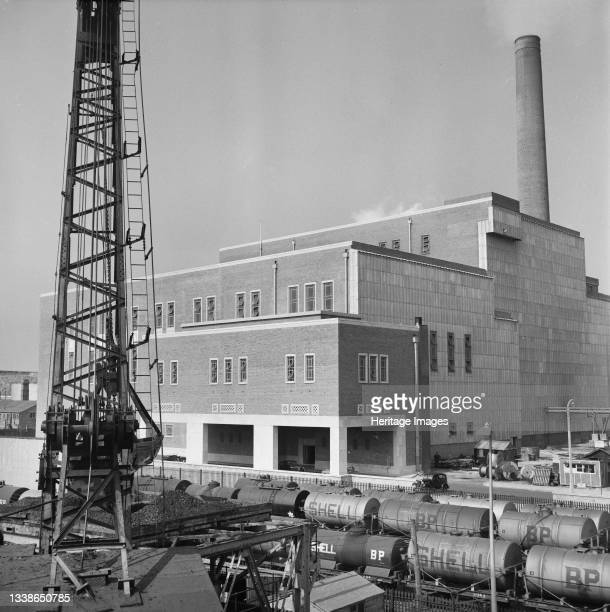 View of Plymouth 'B' Power Station with a piling frame in the foreground, taken during construction of the station's coaling wharf. This image was...