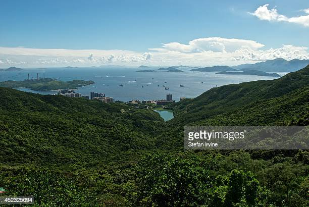 A view of Pok Fu Lam country park and Pok Fu Lam reservoir with the West Lamma Channel and various outlying islands including Lamma and Lantau beyond