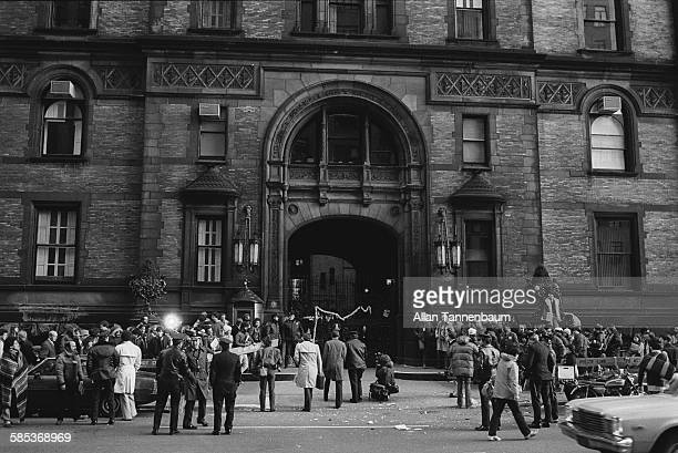 View of police members of the media and fans outside the Dakota Apartments during a memorial vigil for murdered musician John Lennon New York New...