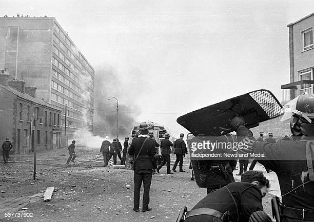 View of police officers from the Royal Ulster Constabulary as they face off with Bogside residents atop the Rossville Flats tower block during the...