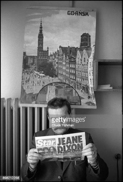View of Polish tradeunionist Lech Walesa as he reads a newspaper clipping at a table in Solidarity headquarters Gdansk Poland December 1980
