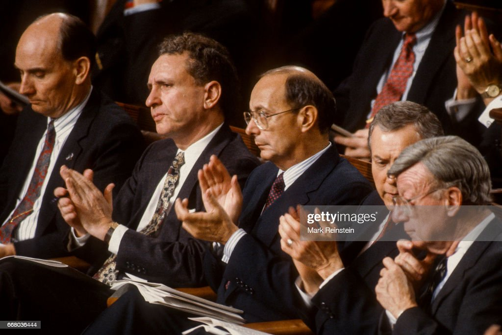 View of politicians as they applaud during President George HW Bush's State of the Union address before a joint session of Congress, Washington DC, January 28, 1992. Among those pictured are, from left, Senators Jake Garn, Arlan Spector (1930 - 2012), Al D'Amato, Orrin Hatch, and William V Roth Jr (1921 - 2003).